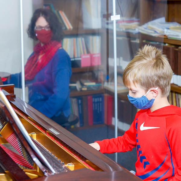 Piano lesson with Covid-safety precautions in place